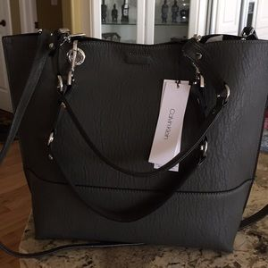 Brand new women's tote with a small purse